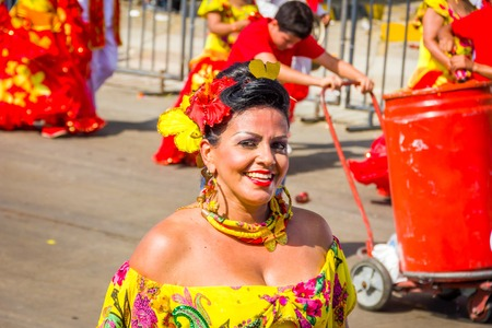 BARRANQUILLA, COLOMBIA - FEBRUARY 15, 2015: Performers with colorful and elaborate costumes participate in the Great Parade of Carnaval dePerformers with colorful and elaborate customs participate in Colombias most important folklore celebration, the Car