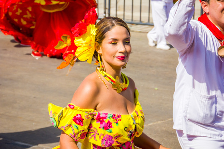 historic world event: BARRANQUILLA, COLOMBIA - FEBRUARY 15, 2015: Performers with colorful and elaborate costumes participate in the Great Parade of Carnaval dePerformers with colorful and elaborate customs participate in Colombias most important folklore celebration, the Car