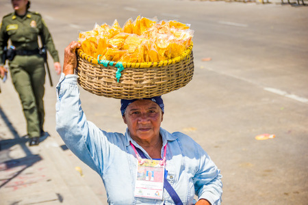 south american ethnicity: BARRANQUILLA, COLOMBIA - FEBRUARY 15, 2015: Street vendors in Colombias most important folklore celebration, the Carnival of Barranquilla, Colombia