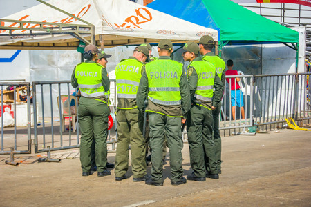 supervise: BARRANQUILLA, COLOMBIA - FEBRUARY 15, 2015: Police supervise the safety in Colombias most important folklore celebration, the Carnival of Barranquilla, Colombia