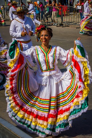 elaborate: BARRANQUILLA, COLOMBIA - FEBRUARY 15, 2015: Performers with colorful and elaborate costumes participate in the Great Parade of Carnaval dePerformers with colorful and elaborate customs participate in Colombias most important folklore celebration, the Car