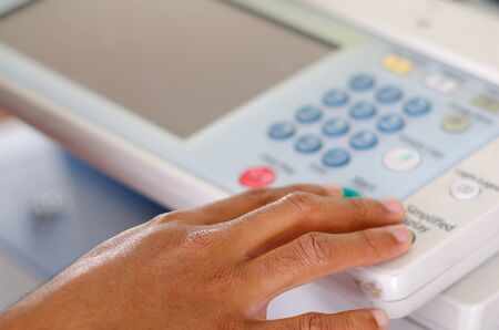 photocopier: Closeup fingers pressing display buttons on photocopier. Stock Photo