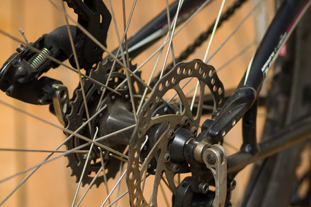 Closeup detailed look at bicycle wheel gear shifting mechanics during maintenance repairs.