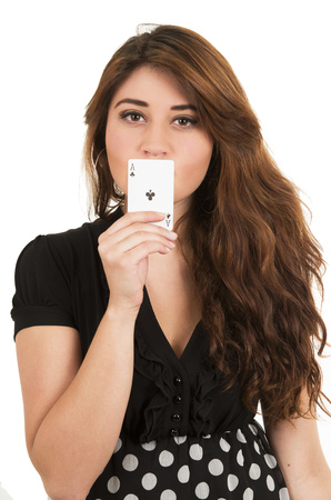 ace of clubs: Beautiful young girl holding ace of clubs card in front of her mouth isolated on white Stock Photo