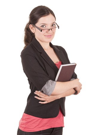 portrait of pretty female teacher wearing glasses and holding book isolated on white Stock Photo