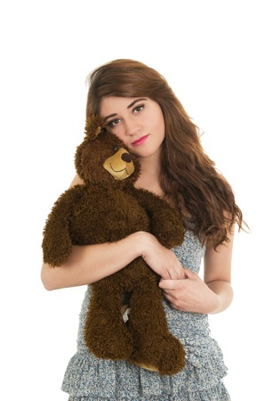 Young beautiful girl hugging teddy bear isolated on white Stock Photo