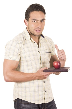 hapy: young hapy male teacher holding notebook and red apple isolated on white