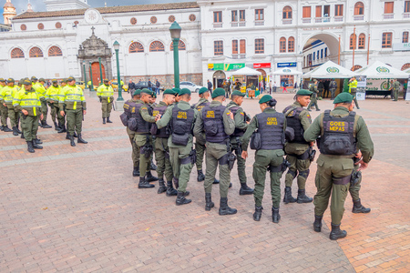 squad: PASTO, COLOMBIA - JULY 3, 2016: police squad wearing lifejackets standing on the central square of the city.