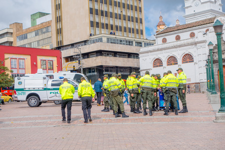squad: PASTO, COLOMBIA - JULY 3, 2016: police squad wearing uniform standing on the central square of the city.
