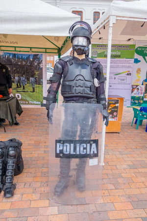 police equipment: PASTO, COLOMBIA - JULY 3, 2016: manikin dessed with police equipment standing in front of a police stand.