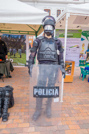 police equipment: PASTO, COLOMBIA - JULY 3, 2016: manikin dressed with some police equipment in nthe center square of the city.