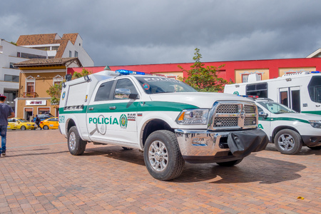 PASTO, COLOMBIA - JULY 3, 2016: police pickup parked in the central square of the city next to some other police vehicles.