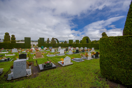 gravesite: TULCAN, ECUADOR - JULY 3, 2016: graves with headstones and flowers adorning them. Editorial