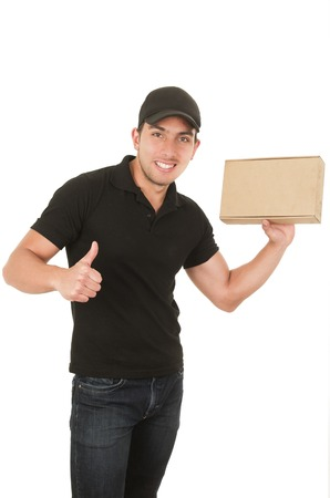 carrying box: happy friendly confident delivery man carrying box holding thumb up isolated on white