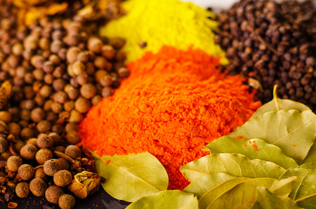 mideast: Closeup from above different piles of colorful spices, beautiful rustic setting, spice and herbal concept. Stock Photo