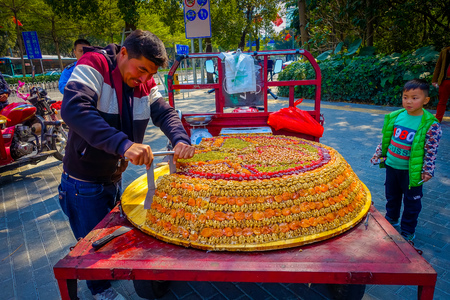 SHENZEN, CHINA - 29 JANUARY, 2017: Street vendor selling traditional arabic turron, sweet mixture of dried fruits and various nuts