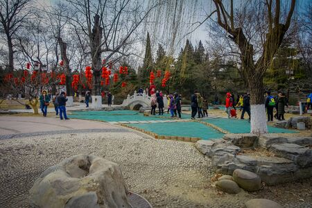 BEIJING, CHINA - 29 JANUARY, 2017: Attending new year celebration festival in temple of earth park, lots of red decorations, music and theatre acts, traditional chinese holiday