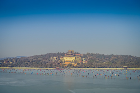 Walking around spring palace complex, a spectacular ensemble of lakes, gardens and ancient chinese palaces, beautiful buildings and architecture.