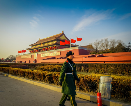 BEIJING, CHINA - 29 JANUARY, 2017: Beautiful temple building inside forbidden city, typical ancient Chinese architecture, soldier marching in front guarding.