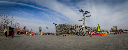 BEIJING, CHINA - 29 JANUARY, 2017: Spectacular birds nest stadium located inside modern olympic sports center, beautiful arena with a unique design and construction, nice blue sky.