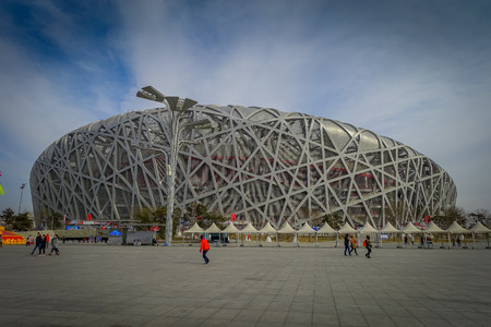 BEIJING, CHINA - 29 JANUARY, 2017: Spectacular birds nest stadium located inside modern olympic sports center, beautiful arena with a unique design and construction, nice blue sky