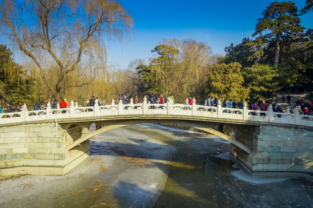 BEIJING, CHINA - 29 JANUARY, 2017: Beautiful suspense bridge crossing ricer inside spring palace complex, a spectacular ensemble of lakes, gardens and ancient chinese palaces Editorial