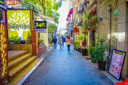 SHANGHAI, CHINA - 29 JANUARY, 2017: Walking around the french concession district of Shanghai, popular destination for tourists with charming streets, shops and restaurants