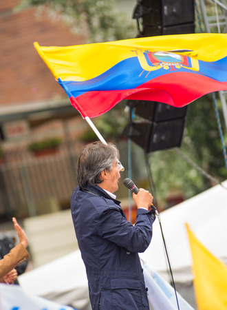 Quito, Ecuador - March 26, 2017: Guillermo Lasso, presidential candidate of CREO SUMA alliance holding the Ecuadorian flag while addressing supporters during his election campaign