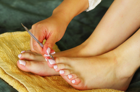 cuticles being pushed back during pedicure