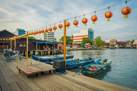 George Town, Malaysia - March 10, 2017: Clan Jetties are unique Chinese settlements existing since the 19th century, along these wooden pier are villages that house the descendants of Chinese immigrants. Editorial