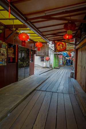 descendants: George Town, Malaysia - March 10, 2017: Clan Jetties are unique Chinese settlements existing since the 19th century, along these wooden pier are villages that house the descendants of Chinese immigrants. Editorial