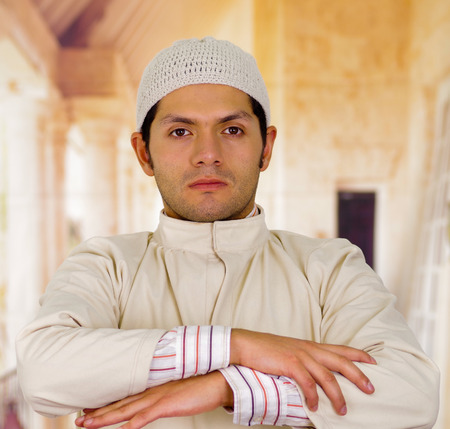 serious arabian man with arms crossed