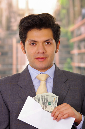 corrupt politician put some money inside of an envelope Stock Photo