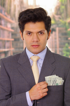 Politician with tie putting money in his pocket