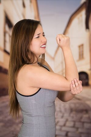Beautiful young woman with elbow pain