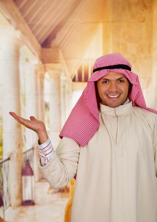 thobe: smiling cute young arabian man posing happy Stock Photo