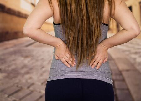 crick: Beautiful lady Suffer cpain in her lower back Stock Photo