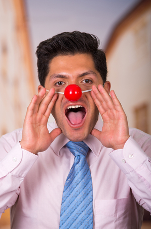 unprofessional: Funny businessman with red plastic nose Stock Photo