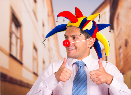 unprofessional: Businessman with a red clown nose Stock Photo