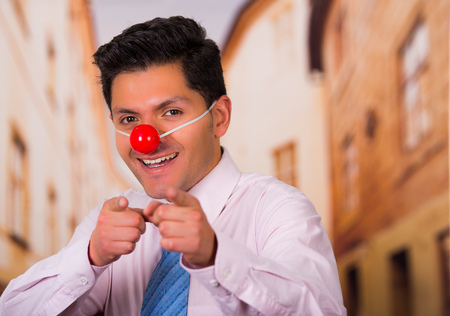 Funny businessman with red plastic nose Stock Photo