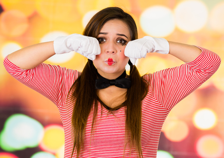Closeup portrait of female clown mime expressing sadness Stock Photo
