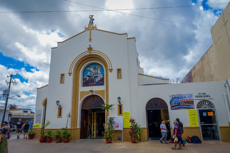 COZUMEL, MEXICO - MARCH 23, 2017: San Miguel Church is full of turist that made lose their original atractive, procession of people pass through the city on April 8, during Easter Mass celebrations
