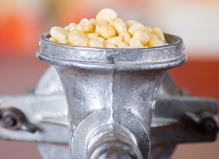 metalic: A close up from a metalic mill with some corn kernels Stock Photo