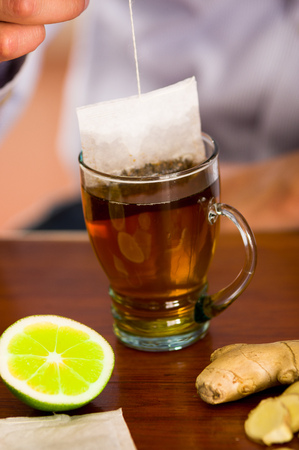 Deleighful cup of tea with ginger and lemon home antimicrobial therapy