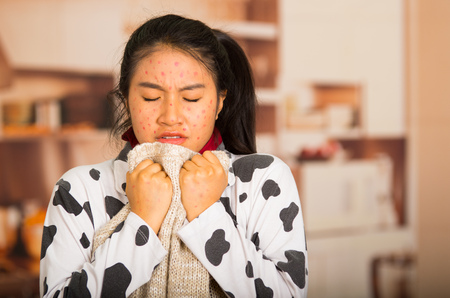 Portrait of young girl with skin problem with a wool sweater around his neck Stock Photo
