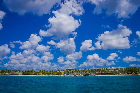 Beautiful attraction of Cozumel with some natural buildings and yachts, gorgeous blue ocean and sky
