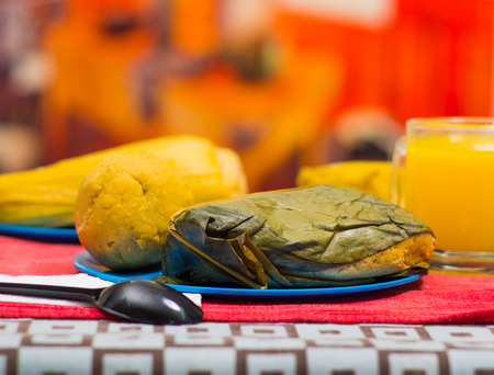 A quick breakfast contain quimbolito and bolon served on a blue plate, traditional andean food concept Stock Photo