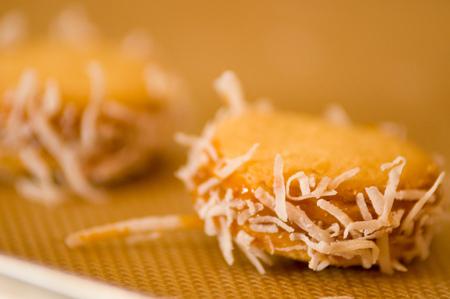 Closeup of a cookie with caramelized milk dulce de leche and coconut, Argentine Cookies Alfajores