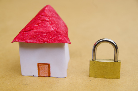 A small and beautifl house model concept of good segurity with a lock padlock, property protection Stock Photo