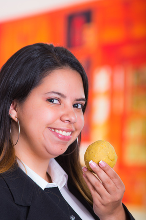 campesino: Gorgeous pretty woman have a bolon in his hand, traditional andean food concept